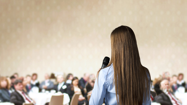 back-view-female-conference-speaker.jpg