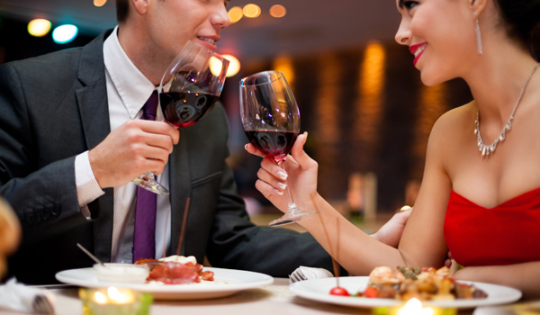 25569069-xxl-hands-of-couple-toasting-their-wine-glasses-over-a-restaurant-table-during-a-romantic-dinner.jpg